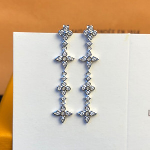 lv louis vuitton dentelle long earrings