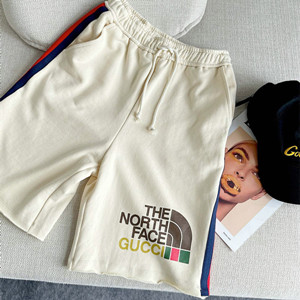 gucci x the north face web print cotton shorts