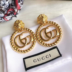 gucci lion head single earring with double g